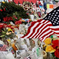 SAN BERNARDINO, CALIF. DEC. 10, 2015 - A memorial to victims of a terrorist attack in San Bernardino continues to grow near the Inland Regional Center on Thursday, Dec. 10, 2015. (Luis Sinco/Los Angeles Times)